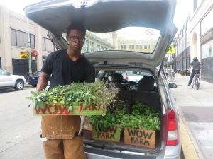 Bilal is delivering fresh herbs and vegetables for Flora.